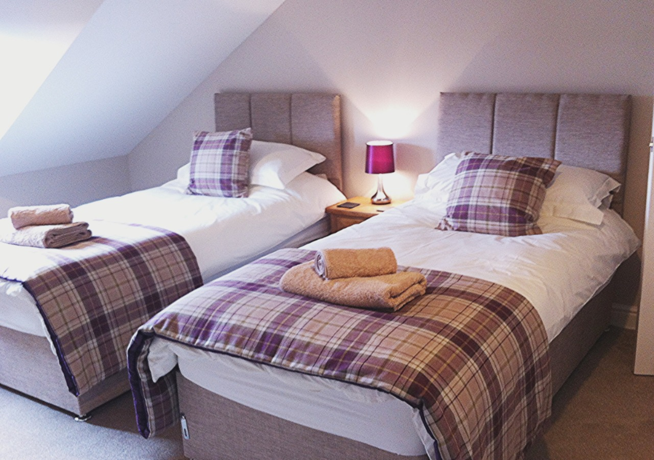 Stylish tartan accessories in the spacious Berriedale bedroom